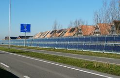Noise barrier with integrated solar panels. Noise barriers with integrated solar panels next to the N470 highway between the cities of Delft, Zoetermeer and stock photos