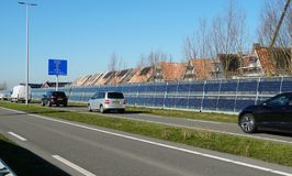 Noise barrier with integrated solar panels royalty free stock photos