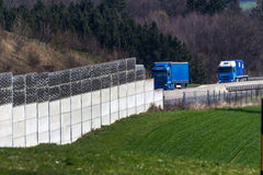 Noise barrier. A noise barrier on the a1 motorway in austria protects the residents against the noise of cars and trucks stock photos
