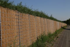 Noise Barrier. View of a noise protection wall on a street stock images
