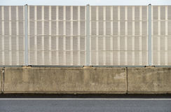 Noise barrier wall beside the highway Stock Images