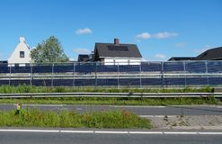 Noise barriers with integrated solar panels. Next to the N470 highway between the cities of Delft, Zoetermeer and Pijnacker in the Netherlands stock image