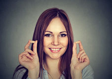 Noise control. Portrait young woman holding ear plugs. On gray wall background stock photos