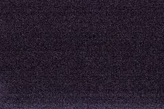 Noise of a digital camera. In black and violet stock photos