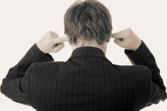 Noise in ears listen fingers businessman royalty free stock image