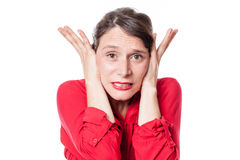 Noise and hearing concept for embarrassed young woman Royalty Free Stock Photo