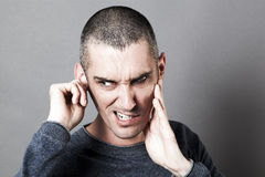 Noise and hearing concept for weird young man Stock Images