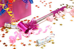 Noise Maker. A pink noise maker with confetti on a white background Stock Photo