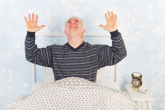 Noise from the neighbours above. Man at night having problems with noise from the neighbours above Stock Photography