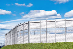 Noise protection fence. Noise protection fence along the new highway stock photos