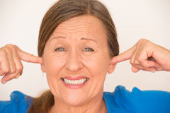 Noise Upset woman covering ears Stock Photos