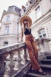 Noise. Vintage Style. Attractive traveler walks on the narrow st stock photo