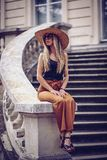 Noise. Vintage Style. Beautiful elegant woman in hat outdoor. Fa. Shion look, european style royalty free stock image