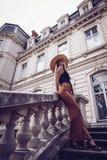 Noise. Vintage Style. Elegant woman travel on street of ukrainian city stock photos