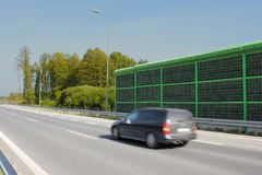 Highway noise barrier, acoustic screen. Car on the sound-absorbing tunnel. Noise wall that protect residents against noise generated by cars royalty free stock images