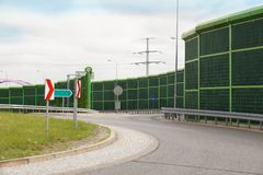 Noise wall. Protection of residents against traffic noise. Departure from the local road to the highway. Noise wall that protect residents against noise royalty free stock image