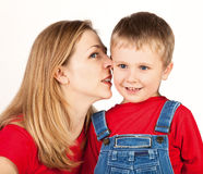 Noiseless Talking. Mother whisper in son's ear Stock Photos