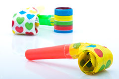 Noisemakers for a party  on white background Royalty Free Stock Image