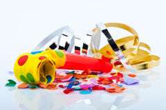 Noisemakers for a party  on white background with air streamers and confetti Royalty Free Stock Images