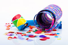 Noisemakers for a party  on white background with air streamers and confetti Stock Image