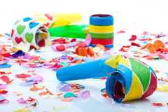 Noisemakers for a party  on white background with confetti Stock Photo