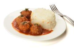 Noisettes avec du riz garnissent Image libre de droits