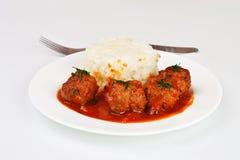 Noisettes avec du riz garnissent Photographie stock