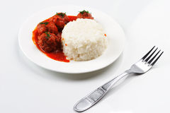 Noisettes with rice garnish Stock Photo