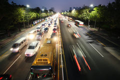 Noisy big highway. Traffic jam. Nightlife and city in lights.  Royalty Free Stock Image