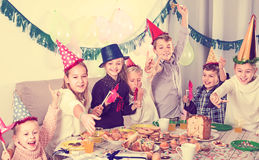 Noisy children having a good time at a birthday party Royalty Free Stock Photography