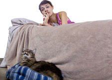 Noisy House Cat. Girl unable to sleep because of noisy pet house cat stock photography