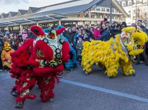 Chinese New Year Parade - The Year of the Dog, 2018. Noisy-le-Grand, France - February 18,2018: The Chinese Lions performing during the Chinese New Year parade royalty free stock photos