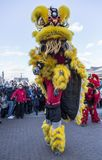 Chinese New Year Parade - The Year of the Dog, 2018. Noisy-le-Grand, France - February 18,2018: The yellow Chinese Lion performing during the Chinese New Year royalty free stock photography