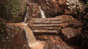 A noisy multistage waterfall falling from a rocky cliff. Small waterfalls. Vietnam. stock footage