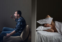 Noisy neighbor. Man at night can't fall asleep because of the noisy neighbor Stock Images