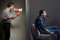 Noisy neighbors. Man at night yells through a megaphone at the noisy neighbor royalty free stock photo