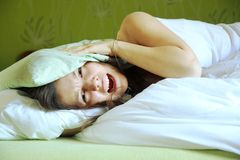 Noisy neighbours. Young woman cant sleep because of noisy neighbours Royalty Free Stock Image