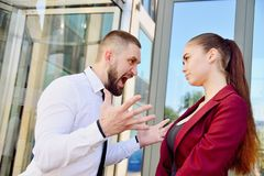 Noisy quarrel with the head of the office employee. A man scream royalty free stock photography