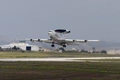 A noisy and smoking AWACS on take off. Royalty Free Stock Photos