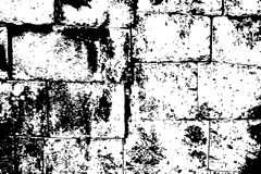 Noisy weathered stone brick wall  texture. Black and white stone bricks. Obsolete stone wall. Royalty Free Stock Photography