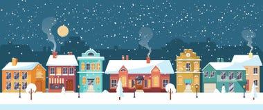 Noite de Natal nevado na cidade acolhedor, panorama Foto de Stock Royalty Free