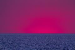 Noite do mar do por do sol Fotos de Stock