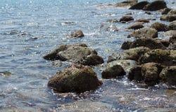 Noite na praia de pedra Imagem de Stock