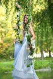 Noiva em um balanço Fotos de Stock Royalty Free