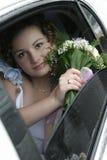 Noiva nova em uma limusina Fotos de Stock Royalty Free