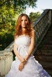 Noiva que levanta em escadas velhas Imagem de Stock Royalty Free
