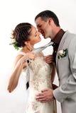 Noiva que puxa o noivo por seu laço para o beijo Fotos de Stock Royalty Free