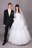 Noivo e noiva bonita no estúdio Fotografia de Stock