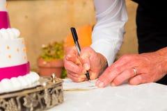 Noivo Signing Marriage Certificate Imagens de Stock