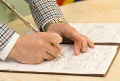 Noivo Signing Marriage Certificate Foto de Stock